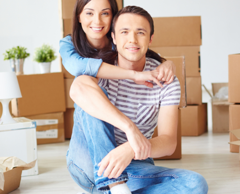 First-time buyer couple in their new home